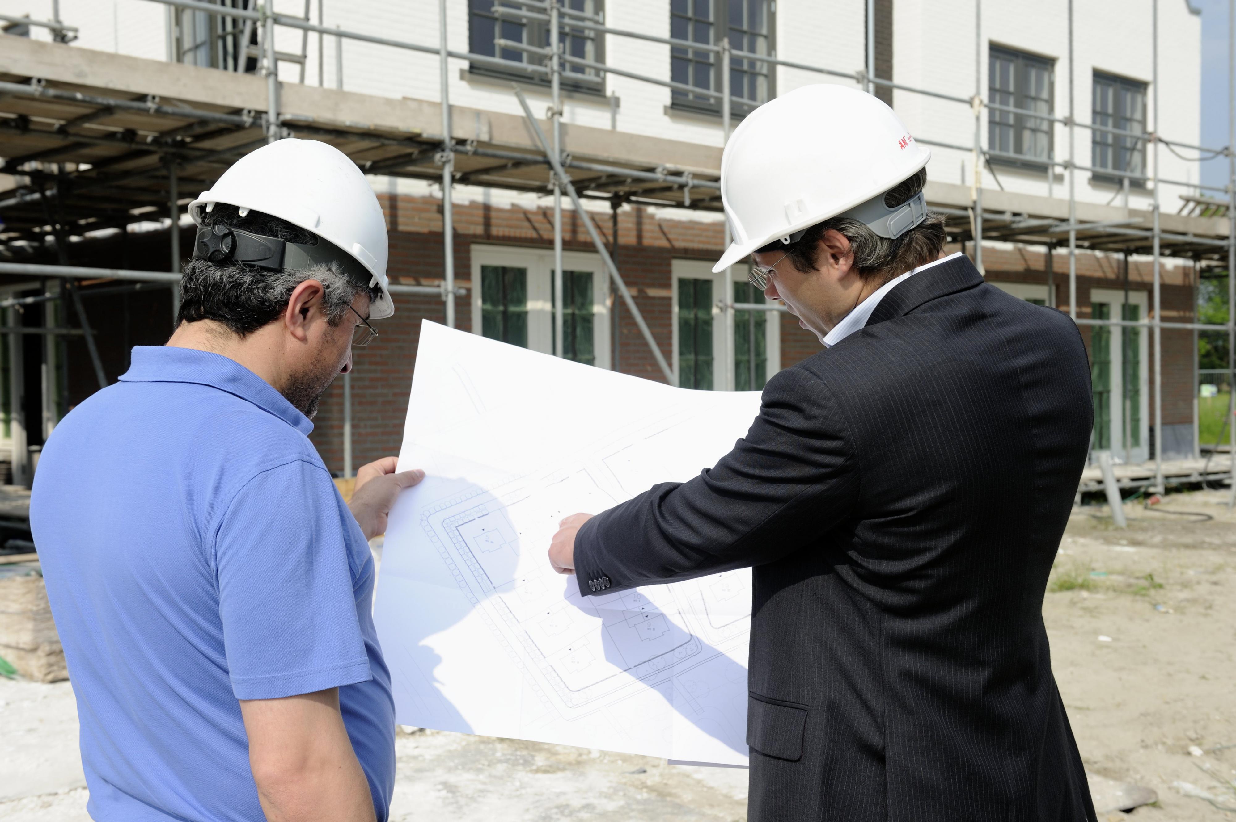 De bezichtiging van een nieuwbouwhuis met de makelaar. Foto: ANP / Lex van Lieshout