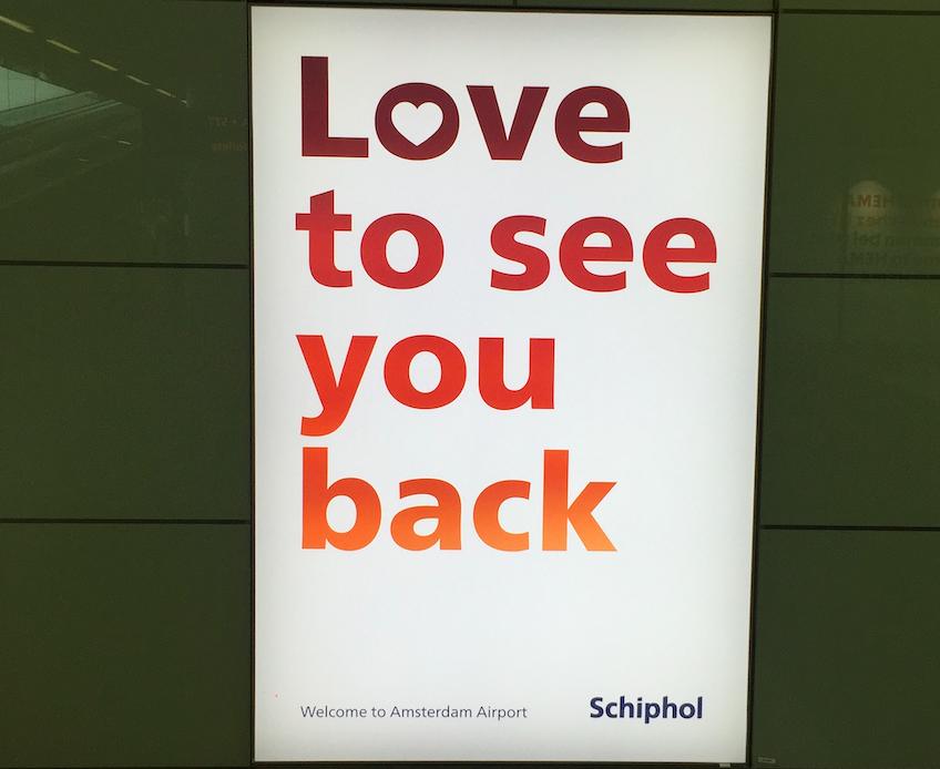 foto van een Schipholposter met Love to see you back erop