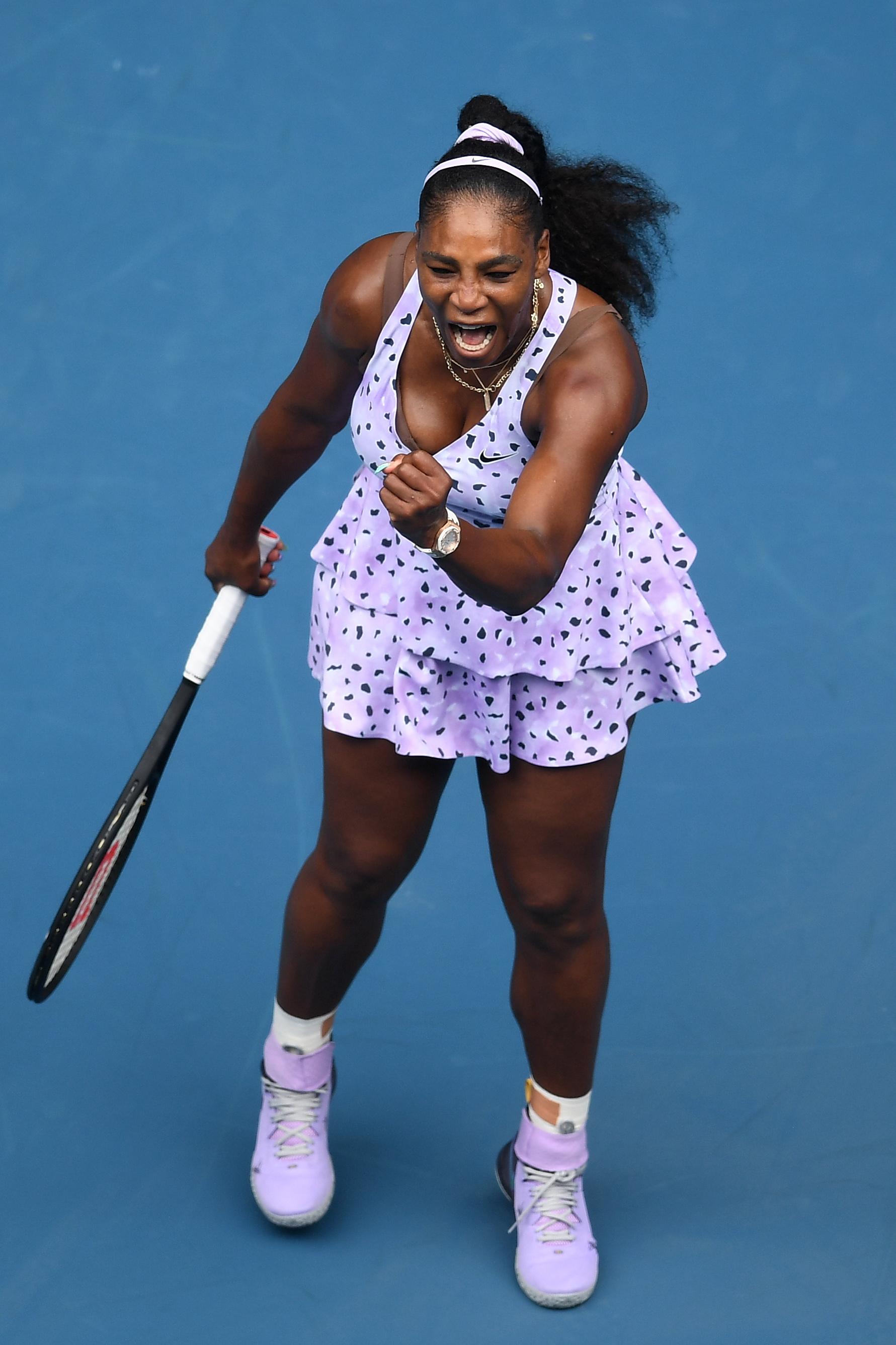 Een foto van een juichende Serena Williams