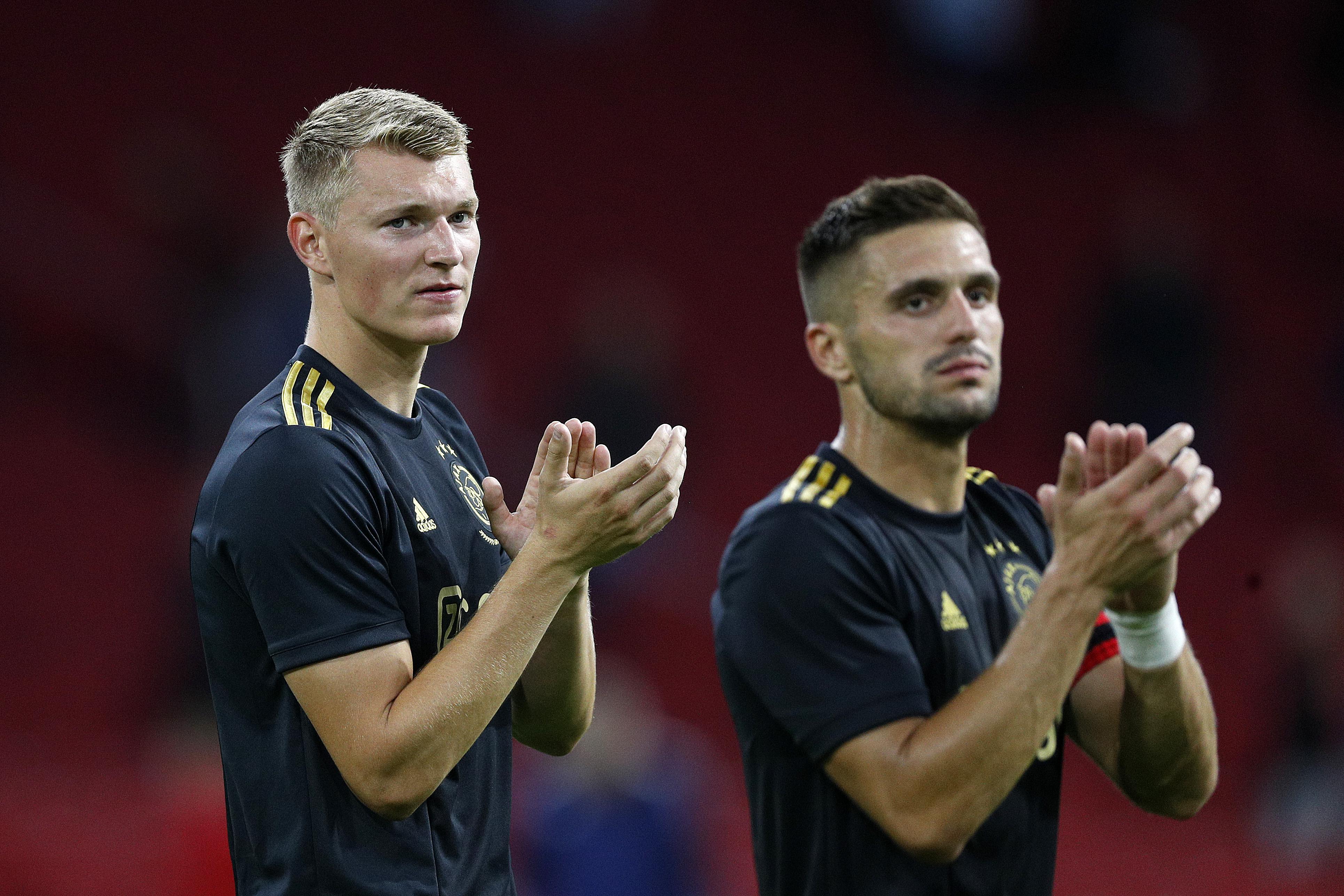 Een foto van Perr Schuurs en Dusan Tadic van Ajax