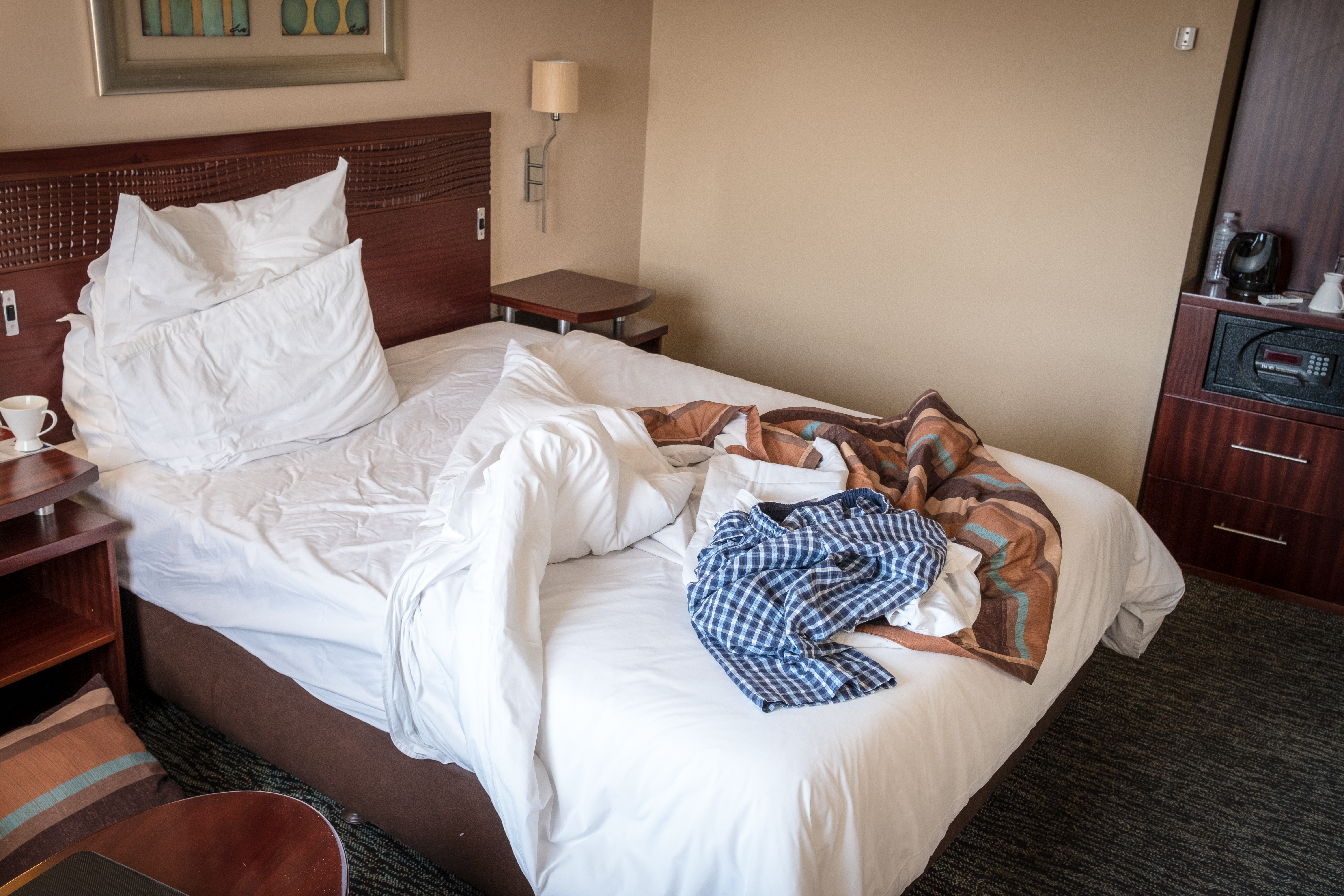 A photo of an untidy hotel room, hotel rooms are often dirty